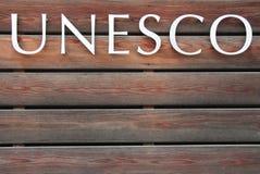 UNESCO-Text auf braunem Hintergrund Stockfotografie