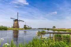 Unesco world heritage windmills. Unesco world heritage site with five windmills standing in a row waiting for the strong wind royalty free stock photo