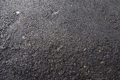 Uneven asphalt texture. On the road Royalty Free Stock Photos
