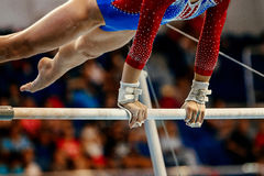 Uneven bars athlete gymnast. To competition in artistic gymnastics stock photography