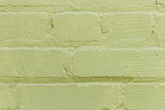Uneven brick wall texture outside green-1 royalty free stock photo