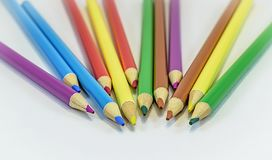 Colored pencils on white background stock images