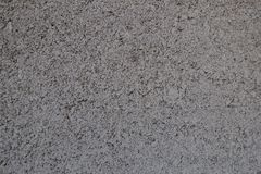 Uneven grainy gray surface of exterior wall. Uneven grainy grey surface of exterior wall royalty free stock photos