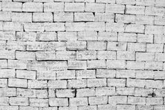 Uneven masonry Brick wall in black and white Stock Image