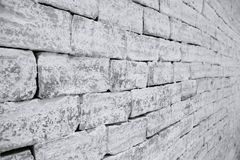 Uneven masonry Brick wall in black and white selective focus taken from a side Stock Photos
