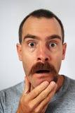 Uneven moustache surprise stock photo