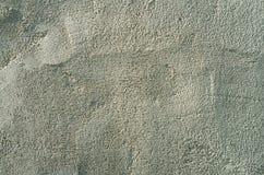 Uneven plaster texture. Concrete rough surface close-up side light Stock Image