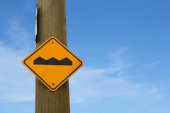 Uneven road sign Stock Photography