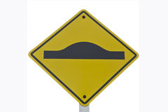 Uneven Road Sign With Pole, isolated on white. Beware of road traffic is not smooth Stock Images