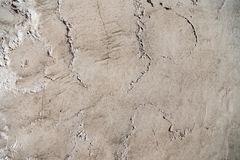 Uneven rough concrete wall. With cracks royalty free stock photography