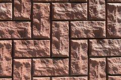 Uneven rough red bricks with asymmetrical masonry. Closeup stone background royalty free stock photos