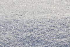 Uneven snowy surface. Of fresh snow in snowdrifts, sparkling in the sunlight, closeup stock image