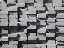 Uneven Stack of Grey Concrete Road Bricks. Background Royalty Free Stock Photos
