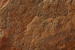 Uneven surface of brown stone Stock Image