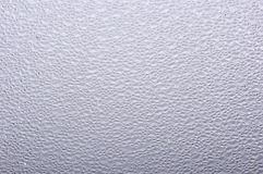 The uneven surface of the glass. Rough surface on the glass Stock Image