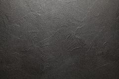 Uneven surface of plastered wall. Black background or texture royalty free stock image