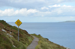 Uneven Surface Sign on the Rocky Mountain Walking Track by the Sea Coast in Ben of Howth, Ireland Stock Images
