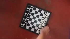 Unexpected flight with the board. A man unexpectedly takes a chess board from the video stock footage