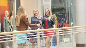 Unexpected meeting friends for shopping,  girls. An unexpected meeting friends for shopping,  all the girls are very happy to see each other, Brag about each stock footage