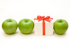 Unexpected present. In row green apples on the white background Stock Image