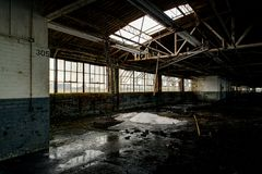 Unexpected Skylight - Abandoned National Acme Factory - Cleveland, Ohio. An unexpected skylight at the abandoned National Acme Factory in Cleveland, Ohio stock photography