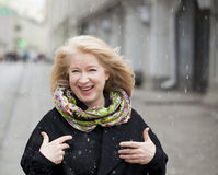 Unexpected snowfall in mid-April, happy portrait of an elderly b Royalty Free Stock Photography