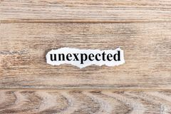 Unexpected text on paper. Word unexpected on torn paper. Concept Image Royalty Free Stock Photos