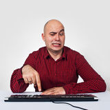Man with computer keybaord Royalty Free Stock Photo