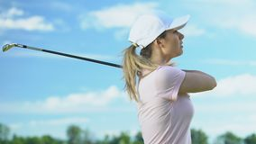 Unexperienced young woman making hits on golf course, practicing in golf, hobby. Stock footage stock footage