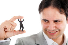 Unfair competition. Big businessman crushing a small one Royalty Free Stock Images