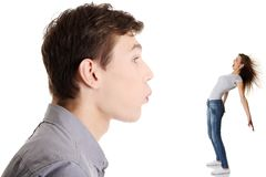 Unfair competition. Concept. Man blowing on women Royalty Free Stock Image