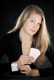 Unfair player. Cardsharper woman - pretty woman pulling ace from sleeve Royalty Free Stock Photos