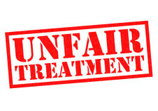 UNFAIR TREATMENT. Red Rubber Stamp over a white background Stock Images