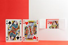 Unfaithful. The king of hearts is caught cheating with the queen of spades Stock Images
