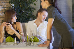 Unfaithful man flirting with waitress Stock Photography