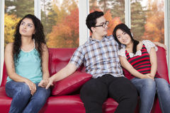 Unfaithful man with girlfriend and his affair Stock Images