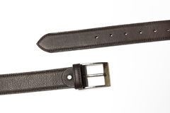 Unfastened brown leather belt Royalty Free Stock Photography