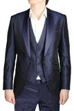 Unfastened navy blue weddings grooms attire, jacket suit, waistc. Unbuttoned night blue men wedding dress with a vest and a white shirt no tie, isolated on a Stock Image
