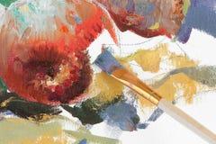 Unfertige Zeichnung des Apfels und des Malerpinsels Stockfoto