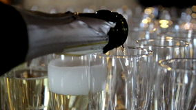 Unfilling the Champagne glasses. Un-filling the lined up champagne glasses. A reverse footage of filling the champagne glasses with the champagne. A waiter stock video footage