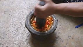 Pounding Thai chili sauce  stock video footage