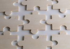 Unfinish puzzles on a wooden background. Puzzles on a wooden background. Concept business. Idea: working in a team. Close up royalty free stock photography