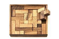 Unfinished. The last piece of a wooden jigsaw puzzle won't fit Royalty Free Stock Photo