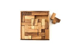 Unfinished. A top down view of a wooden puzzle with one piece that will not fit in Royalty Free Stock Photography