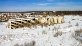 The unfinished and abandoned building. Stands on a snow-covered field Stock Images