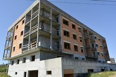 Unfinished abandonned Apartment Block structure. Unfinished Abandonned Building Block showing Structure under a blue sky royalty free stock photos