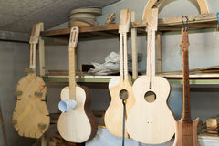 Unfinished acoustic guitars Stock Photo