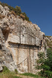 Unfinished ancient tomb near medieval Kritinia castle. On Rhodes island, Greece Royalty Free Stock Photos