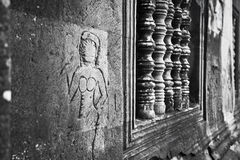 An unfinished Apsaras in Angkor Wat Stock Photos