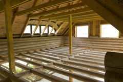 Unfinished attic floor of wooden cabin Royalty Free Stock Images